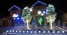 Christmas Lights That Go Along With Music Family Decorates Home With Over 25k Christmas Lights