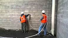 Insulating Concrete Block Walls Injection Foam Into Cinder Block Construction Youtube