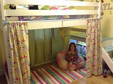 white c loft bed with added book shelf and