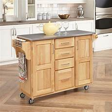 white kitchen island with stainless steel top kitchen islands and carts make even a small kitchen seem