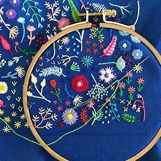 tiny embroidery stitches small blooms into spontaneous
