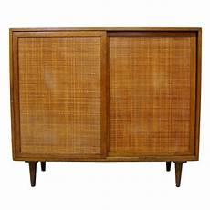 harvey probber mahogany and rattan cabinet at 1stdibs