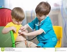Children Play Doctor Children Boys Play Doctor At Home Stock Photo Image Of