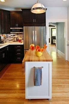 8 Exles Of Kitchens With Movable Islands That Make It Before After Small Kitchen Renovation Kitchen Design