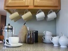 this idea for cabinet storage mug storage