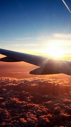travel wallpaper iphone above the clouds sunset clouds aiirplane god cool