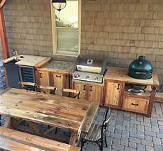 outdoor kitchen with matching grill cabinet beverage bar
