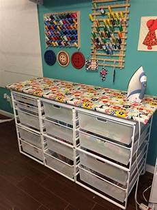 quilting ironing station with lots of fabric storage