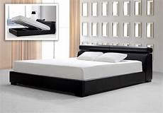 logan black leatherette platform bed w storage