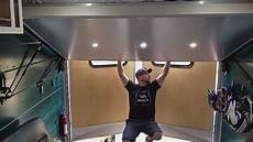 bed lifts to ceiling in this diy stealthy cargo trailer