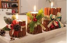 composizioni candele decorazioni natalizie in the wind