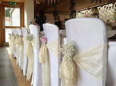 wedding chair hoods hire white google search wedding wedding chair sashes google search baby s breath tucked