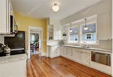 White Kitchen Cabinets Light Floor Kitchen Interior With White Cabinets Yellow Walls And