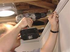 How To Install Ceiling Light In Old House How To Install An Acoustic Drop Ceiling How Tos Diy