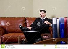 Office Takeout Businessman Sitting On Leather Couch In Office Royalty