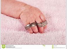 Baby Holding Wedding Rings Royalty Free Stock Image