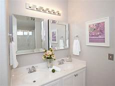 One Light Fixture Over Two Mirrors White Bathroom With Double Vanity And Chrome Fixtures Hgtv