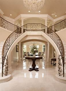 luxury iron banister dual staircase grand entryway