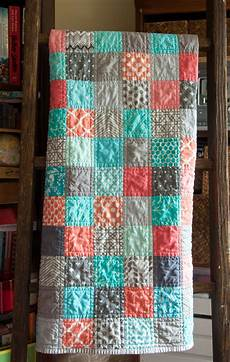 modern baby patchwork quilt colors corals blue and grays