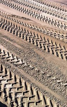 Sand Tracks Design Back Hoe Patterns In The Sand San Francisco Texture