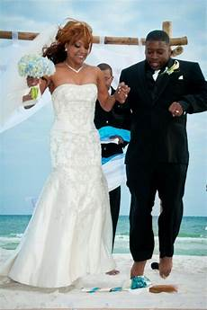 bride and groom jump the broom african american tradition