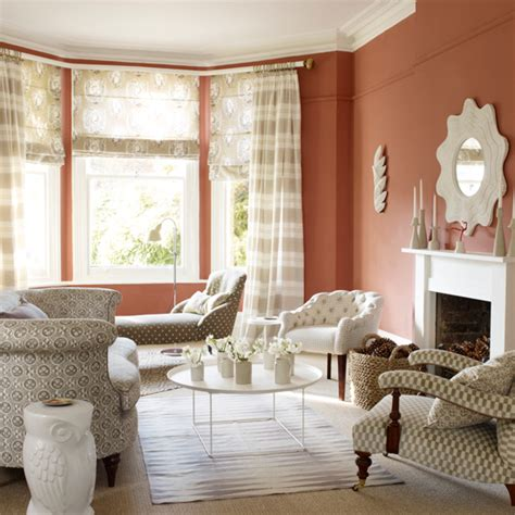 terracotta colour schemes for living rooms terracotta living room with patterned fabric living room decorating ideas ideal home