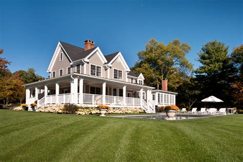 colonial farmhouse with wrap around porch sloan architects p c millbrook new york