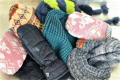 an inexpensive solution to storing hats mittens and scarves