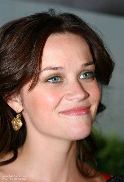 brunette reese witherspoon with layered and rolled hair