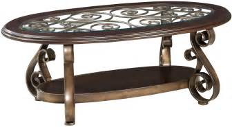 Old world cocktail table with glass top and s scroll legs by standard