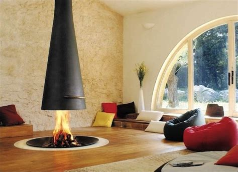 open fireplace in the middle of the room cozy homes