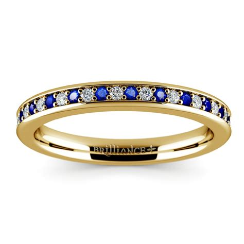 pave sapphire wedding ring in yellow gold