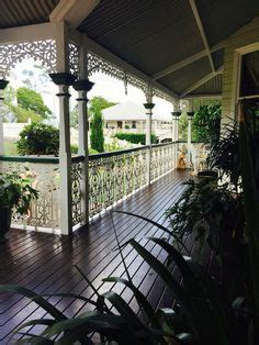 veranda doors queenslander clay tile roof brown gutters wrought iron fixtures
