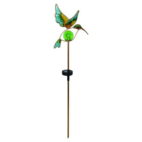 solar powered hummingbird lights moonrays solar powered led brown tiki warrior light 95960