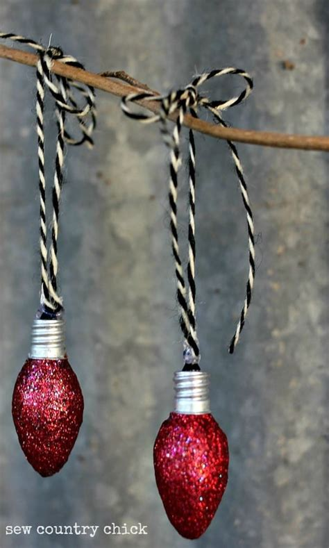 christmas ornaments made from light bulbs light bulb ornaments mod podge rocks