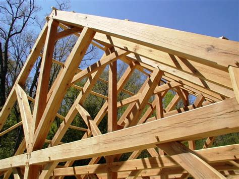 a frame roof design timber frame trusses create an open and dramatic effect