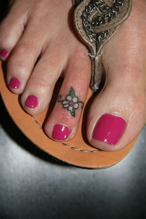 small toe tattoos small quot toe ring quot flower on the toe foot saad from