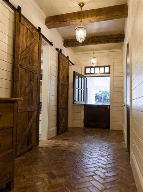 country entryway with brick floors saloon door barn door - Barn Door Height Floor