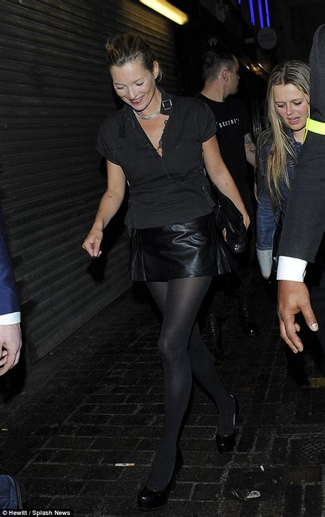 kate moss is a picture of in tiny leather mini