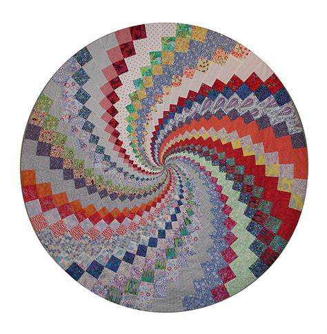 quilt pattern vortex collector with a needle multi colored vortex in variation