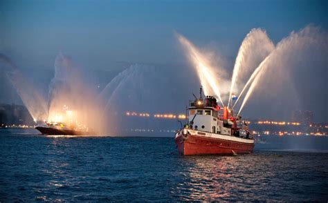a fireboat in the harbor is helping it s your waterfront