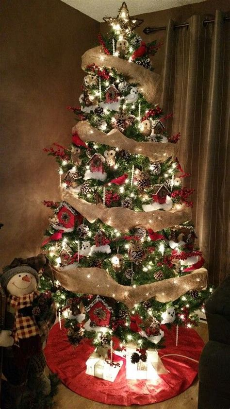 decorating christmas trees with berries tree decorated in white and brown coloured decorations burlap ribbon
