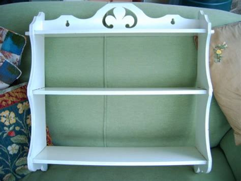 pretty vintage wooden white display shelves