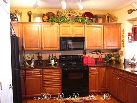 Decorating Tops Of Kitchen Cabinets by Whats On Top Of Your Kitchen Cabinets Home Decorating Amp
