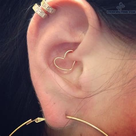 tattoo on back of ear cartilage double cartilage daith ear heart piercing tattoo