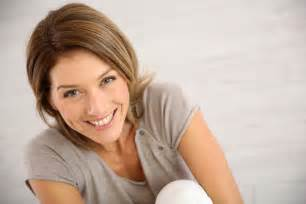 middle aged portrait of smiling middle aged woman quality sleep care
