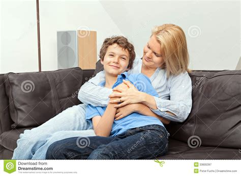 mom son couch mother and son sitting on a couch royalty free stock