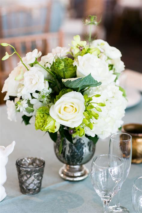 classic white rose centerpiece in mercury glass vase