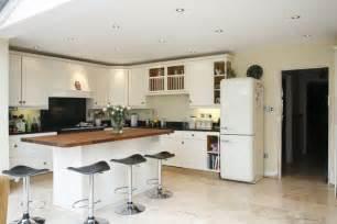 Breakfast bar adjoining the kitchen island kitchen ideas