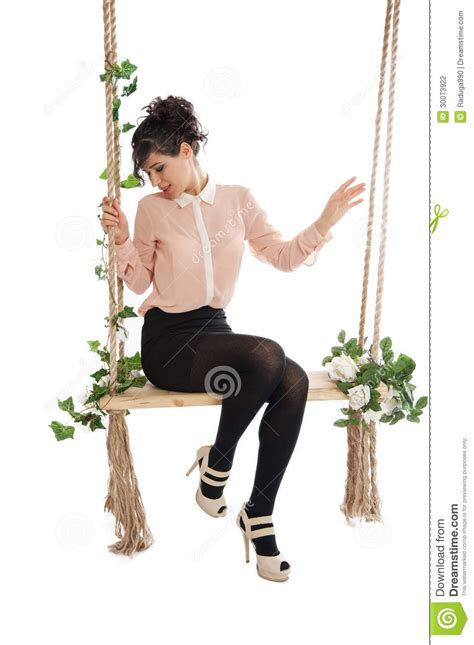 sitting on a swing a woman is sitting on a swing stock photography image